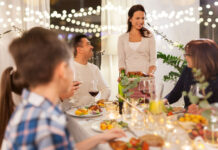celebration, holidays and people concept - happy family having dinner party at home