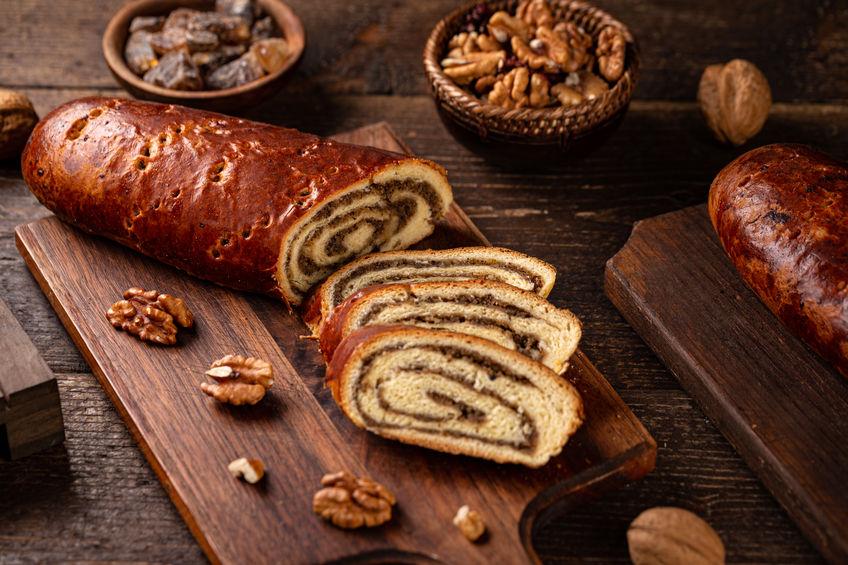Walnut rolls, traditional Hungarian Chistmas beigli cake on wooden board