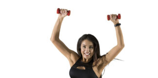 Sporty woman with red dumbbells on white background